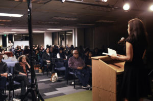 Literary Uprising audience listens to a reading